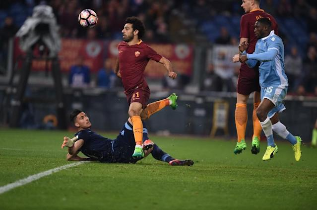Roma's midfielder Mohamed Salah scores during the Italian Tim Cup second leg semi-final football match AS Roma vs Lazio on April 4, 2017 at the Olympic stadium in Rome (AFP Photo/Filippo MONTEFORTE )