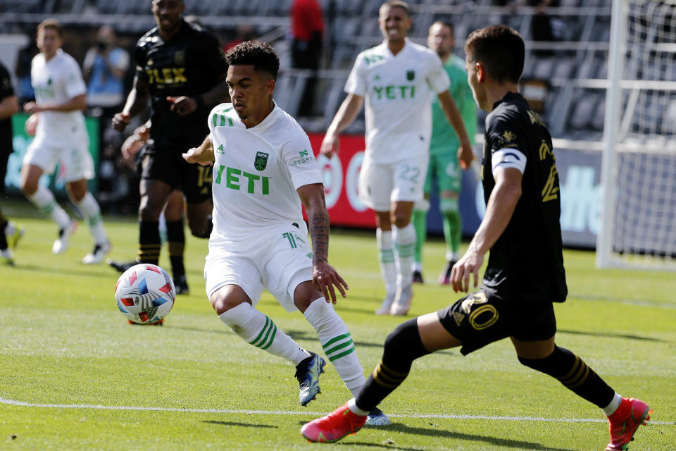 Austin FC midfielder Daniel Pereira Gil (15) controls the ball away from Los Angeles FC midfielder Eduard Atuesta (20) during the second half of an MLS soccer match Saturday, April 17, 2021, in Los Angeles. (AP Photo/Ringo H.W. Chiu)