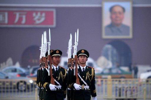"<p>Honor guards are seen marching during a daily flag-lowering ceremony in Beijing, on March 6, 2013. China's newly-installed president Xi Jinping has close ties to the country's expanding military and on Sunday called for the armed forces to strengthen their ability to ""win battles.""</p>"