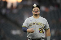 Milwaukee Brewers first baseman Daniel Vogelbach heads to his position in the fifth inning of a baseball game against the Colorado Rockies, Thursday, June 17, 2021, in Denver. (AP Photo/David Zalubowski)