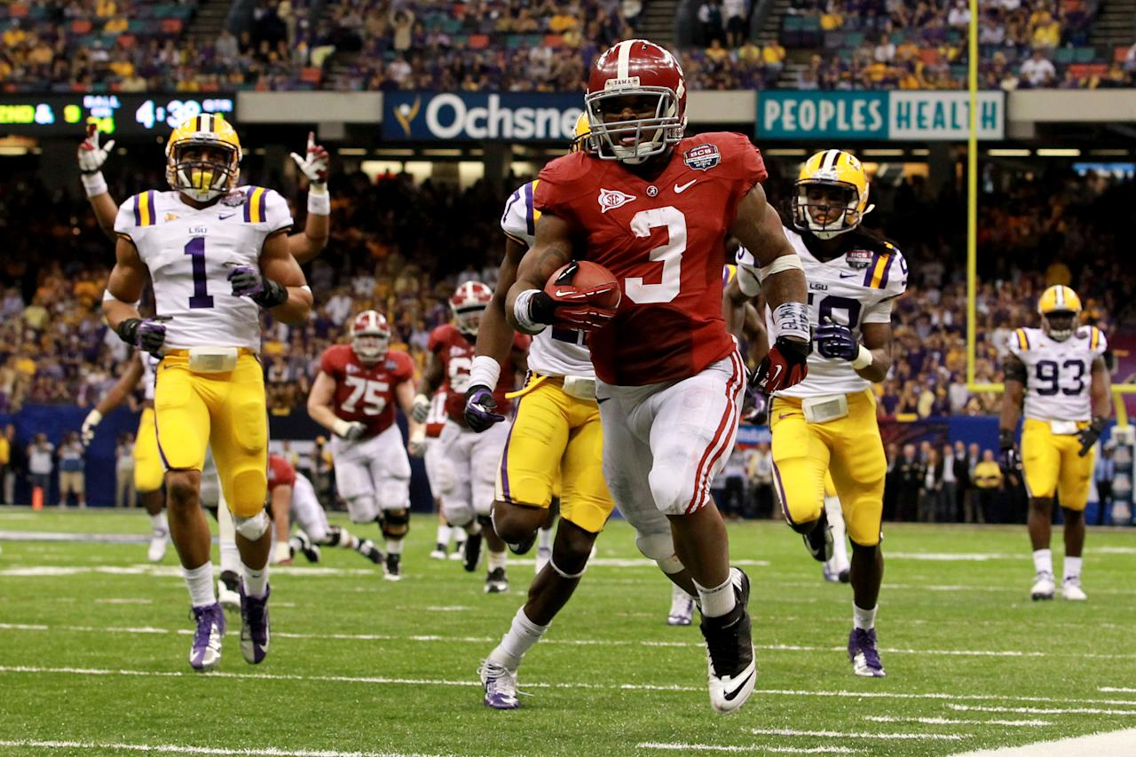 NEW ORLEANS, LA - JANUARY 09:  Trent Richardson #3 of the Alabama Crimson Tide runs for a 34 yard touchdown in the fourth quarter against Morris Claiborne #17 of the Louisiana State University Tigers during the 2012 Allstate BCS National Championship Game at Mercedes-Benz Superdome on January 9, 2012 in New Orleans, Louisiana.  (Photo by Ronald Martinez/Getty Images)