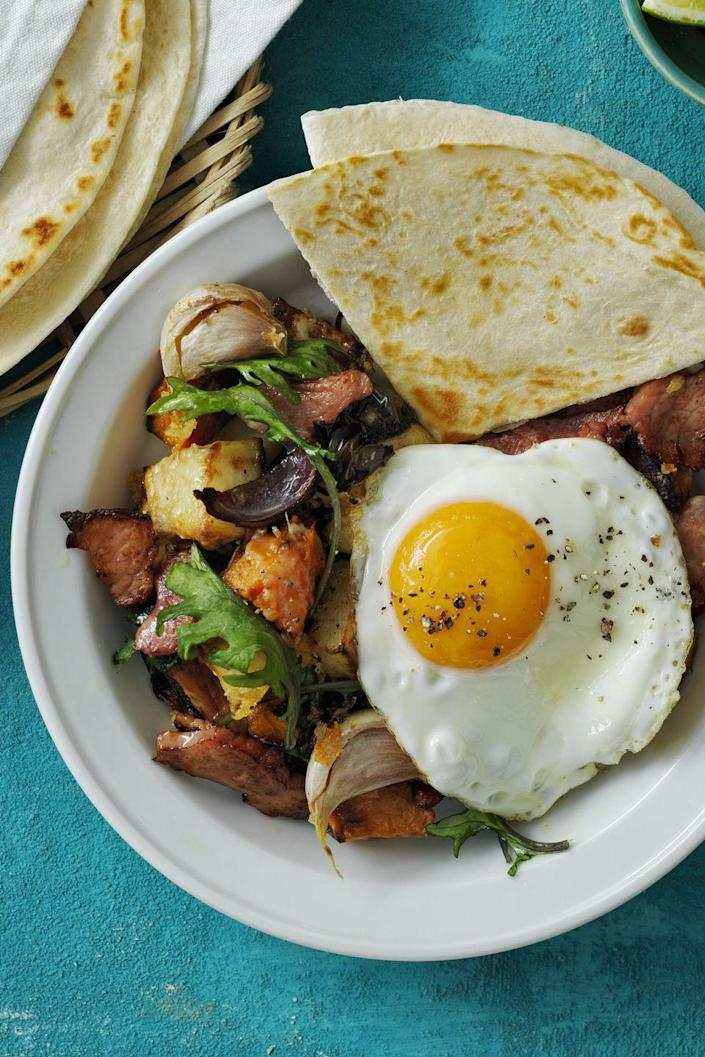 "<p>Kale, sweet potato, ham, and cheddar make up this unforgettable hash that works for any meal of the day.</p><p><em><a href=""https://www.womansday.com/food-recipes/food-drinks/recipes/a58141/roasted-poblano-potato-ham-hash/?visibilityoverride"" rel=""nofollow noopener"" target=""_blank"" data-ylk=""slk:Get the Roasted Poblano Potato and Ham Hash recipe."" class=""link rapid-noclick-resp"">Get the Roasted Poblano Potato and Ham Hash recipe.</a></em></p>"