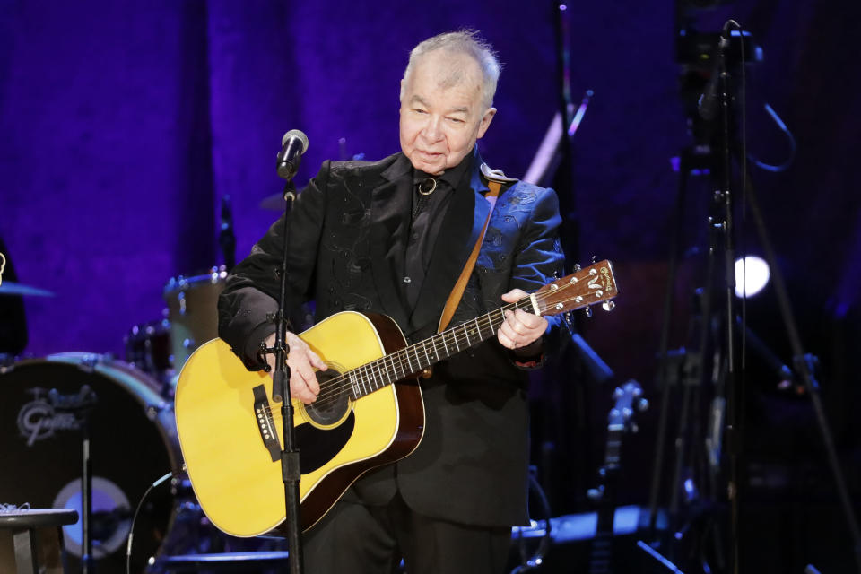 """FILE — In this Sept. 11, 2019, file photo, John Prine performs at the Americana Honors & Awards show in Nashville, Tenn. The icon earned two posthumous Grammy nominations, including best American Roots performance and best American Roots song for """"I Remember Everything."""" Prine died April 7, 2020, from complications of the coronavirus. He was 73. (AP Photo/Wade Payne, File)"""