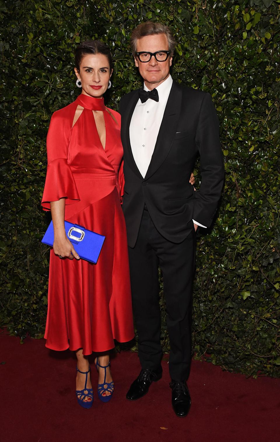 <p>Livia donned an eco-friendly red dress by Temperley while Colin went for his usual bow tie and suit. <i>[Photo: Getty]</i> </p>