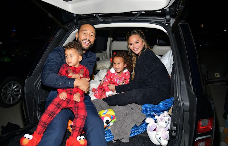 Teigen has been open about her own infertility struggles, pictured with husband John Legend and children Miles and Luna in November 2020. (Getty Images)