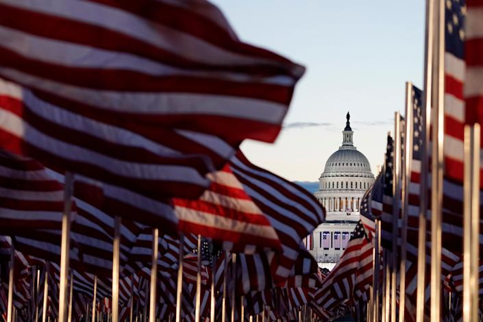 Flags covered the National Mall for the inauguration. (Photo: Julio Cortez/Associated Press)