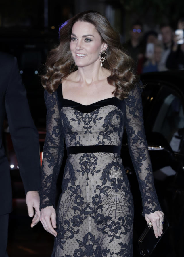 Kate hair had been styled in glamorous curls, her beauty look finished off with a smokey winged eyeliner. [Photo: Getty]