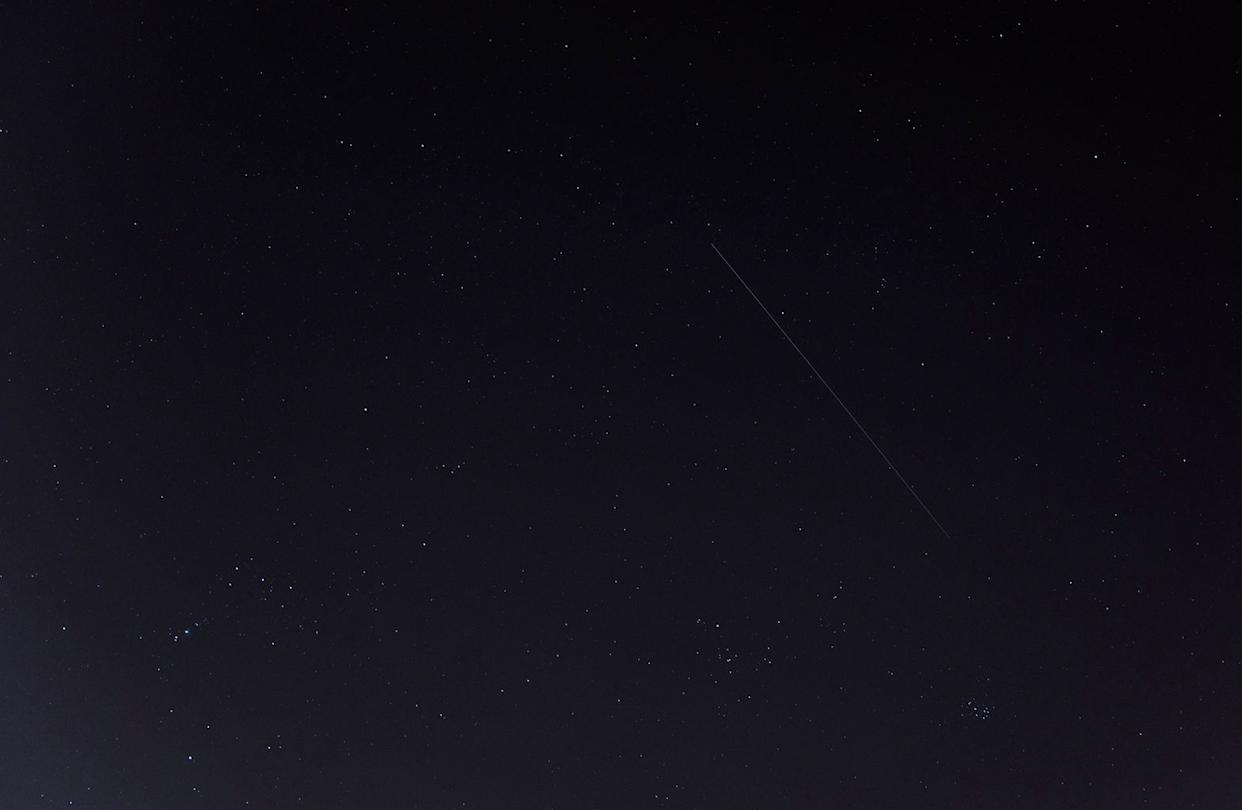 "This photo of China's Tiangong-1 space station module streaking overhead was captured by Gianluca Masi of the Virtual Telescope Project in Rome on March 9, 2018. The spacecraft will fall to Earth between March 30 and April 1. The constellations Orion, Auriga and Taurus are also visible. <cite>Gianluca Masi/<a href=""http://www.virtualtelescope.eu"" rel=""nofollow noopener"" target=""_blank"" data-ylk=""slk:Virtual Telescope Project"" class=""link rapid-noclick-resp"">Virtual Telescope Project</a></cite>"