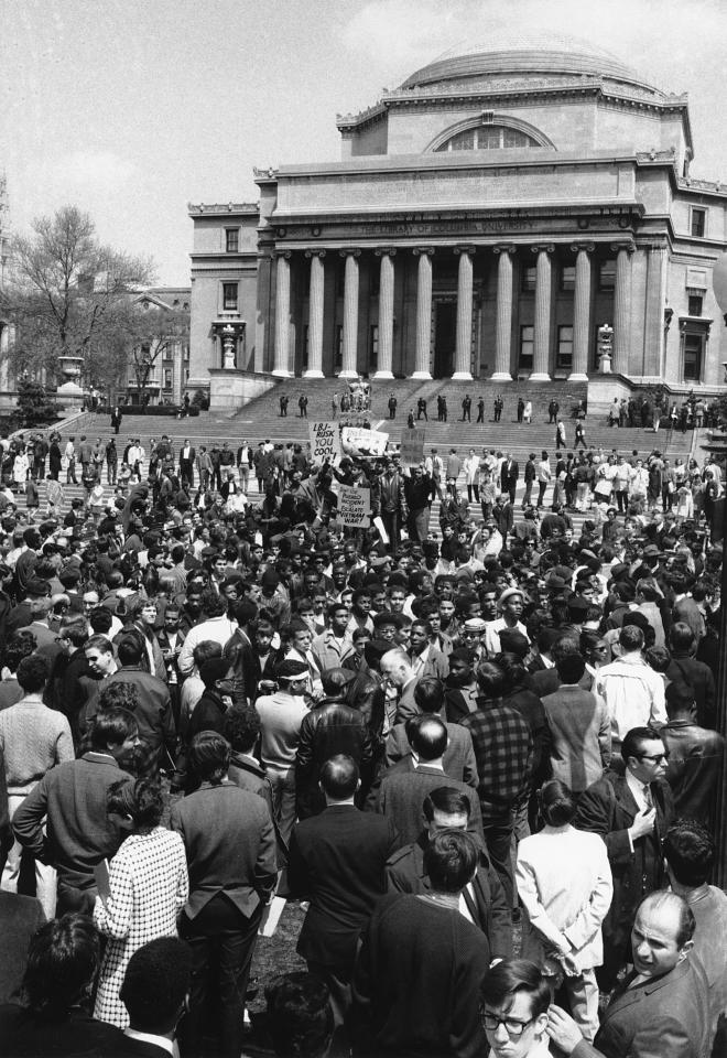 FILE – In this April 27, 1968 file photo, demonstrators and students protest at the plaza in front of Columbia University's Low Memorial Library in New York. Fifty years ago, students occupied five buildings at the university and shut down the Ivy League campus in a protest over the school's ties to a military think tank and what protesters saw as racism toward Columbia's Harlem neighbors. More than 700 protesters were arrested and more than 130 were injured when police retook the occupied buildings, during what was part of a year of global turmoil. (AP Photo, File)