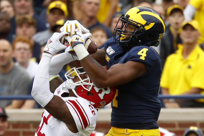 Rutgers defensive back Damon Hayes (22) intercepts a pass intended for Michigan wide receiver Nico Collins (4) in the second half of an NCAA college football game in Ann Arbor, Mich., Saturday, Sept. 28, 2019. (AP Photo/Paul Sancya)