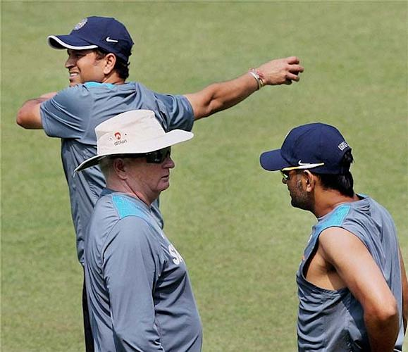 Sachin Tendulkar warming up but Dhoni and Fletcher has a few things to take care of