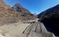 A view of the damaged Dhauliganga hydropower project at Reni village in Chamoli district after a portion of Nanda Devi glacier broke off in Tapovan area of the northern state of Uttarakhand, Sunday, Feb.7, 2021. (AP Photo)