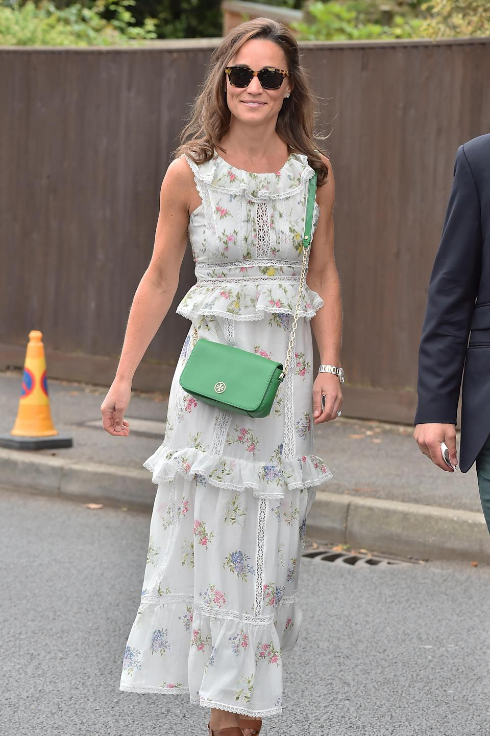 <p>Continuing her sartorial Wimbledon reign, Pippa wore a Max Mara cotton dress costing £687 to the 2017 tournament, which she paired with a green cross-body bag. <br><em>[Photo: Getty]</em> </p>