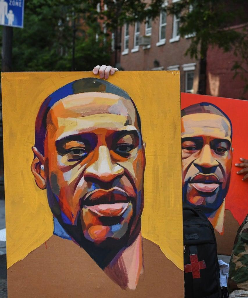 NEW YORK, NY – JUNE 06: Protesters take a break and pose for a photo with two portraits of George Floyd on June 6, 2020 in New York City. This is the 12th day of protests since George Floyd died in Minneapolis police custody on May 25. (Photo by Stephanie Keith/Getty Images)