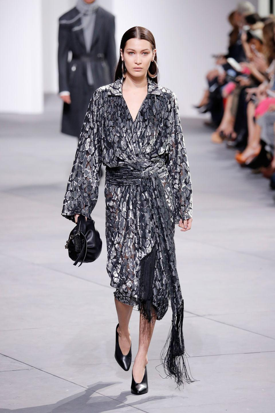 <p>Bella did 80s luxe workwear at Michael Kors AW17 at NYFW</p>