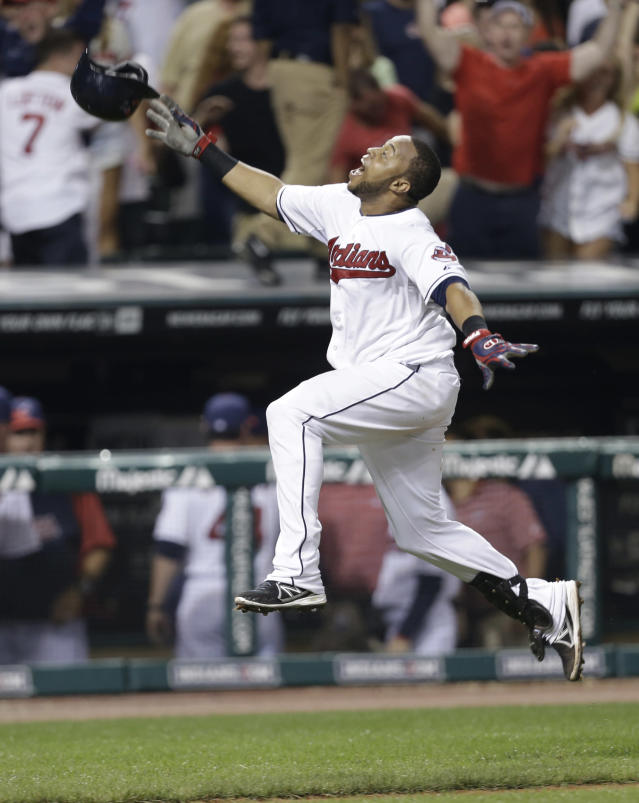 Cleveland Indians' Carlos Santana celebrates after rounding third base on his solo home run off Chicago White Sox relief pitcher Dylan Axelrod in the 10th inning of a baseball game, Wednesday, July 31, 2013, in Cleveland. The Indians won 6-5 in 10 innings. (AP Photo/Tony Dejak)