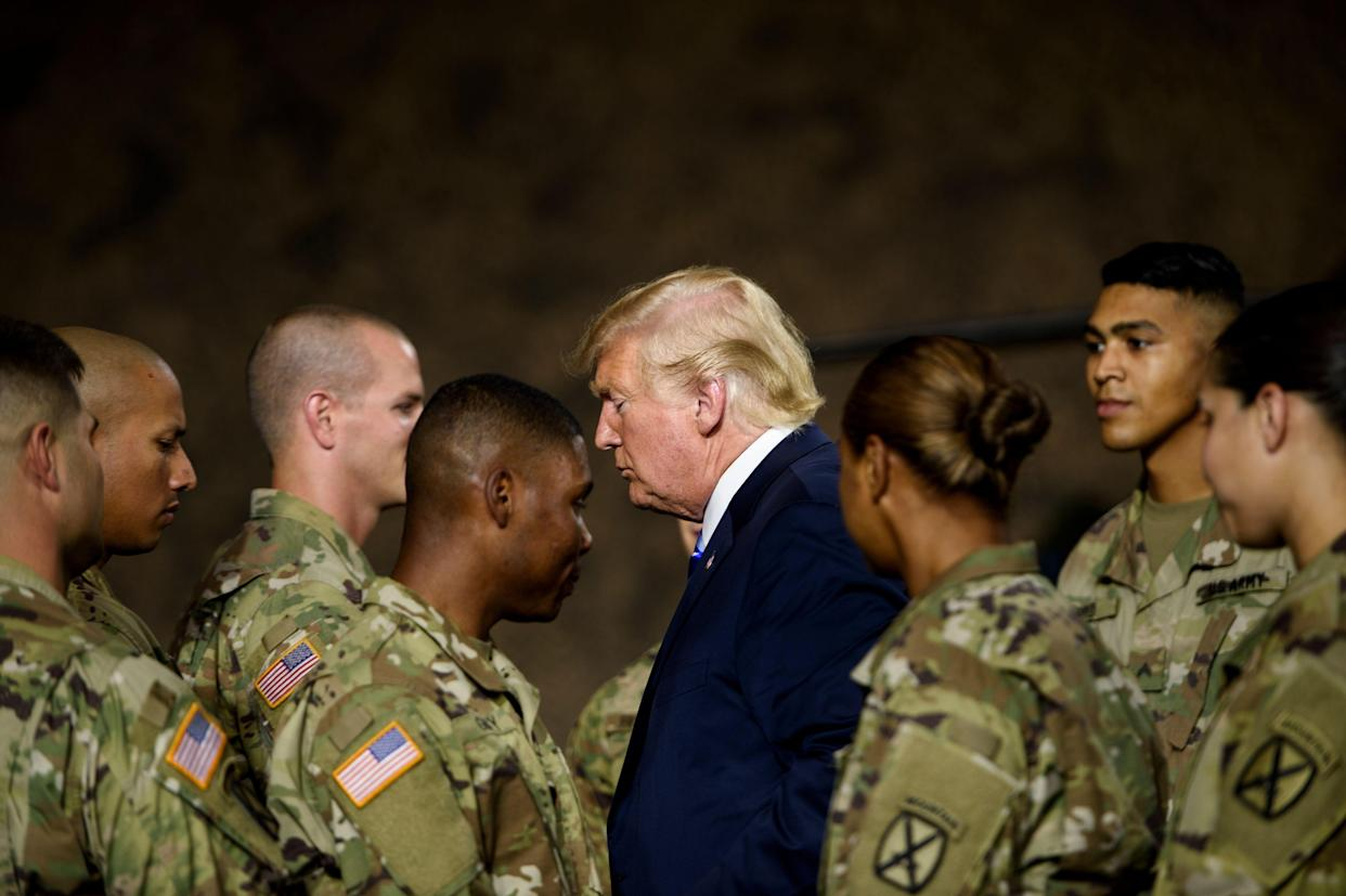 Then-President Donald Trump leaves after signing the John S. McCain National Defense Authorization Act for Fiscal Year 2019 at Fort Drum, N.Y., on Aug. 13, 2018. (Brendan Smialowski/AFP via Getty Images)