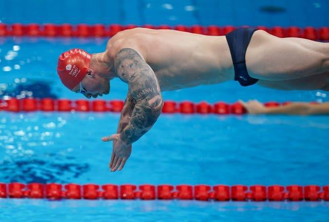 Britain's biggest gold medal hope, Adam Peaty, dives into the pool during a training session