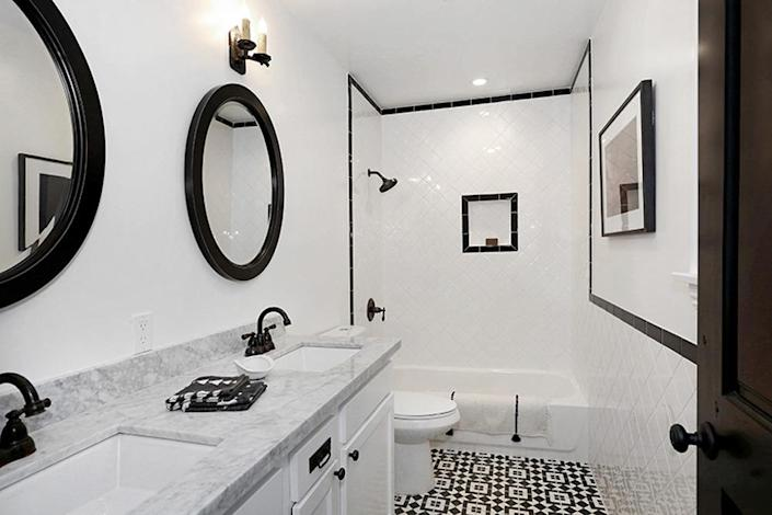 <p>This master bathroom is a far cry from the bathroom Kenihan found when he first purchased the house. At the time, the floors were so rotted that the bathtub of the home's sole bathroom had fallen through the floor and into the basement.<i> (Photo: Charmaine David for Kenihan Development)</i></p>
