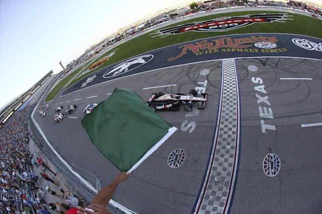 In a photo provided by IndyCar, Will Power, of Australia, takes the green at the start of the IndyCar auto race at Texas Motor Speedway in Fort Worth, Texas, Saturday, June 7, 2014. (AP Photo/IndyCar, Jonathan Ferry)