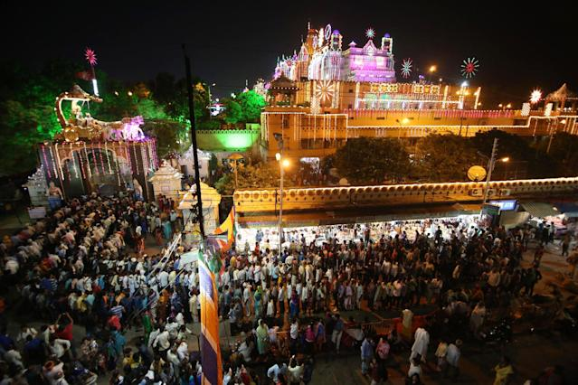 <p>Indian Hindu devotees queue to enter the Sri Krishna Janamsthan temple on the eve of 'Krishna Janamshtami' festival, in Mathura on September 2, 2018. – 'Krishna Janmashtami' is an annual Hindu festival that celebrates the birth of Krishna. (Photo by AFP/Getty Images) </p>