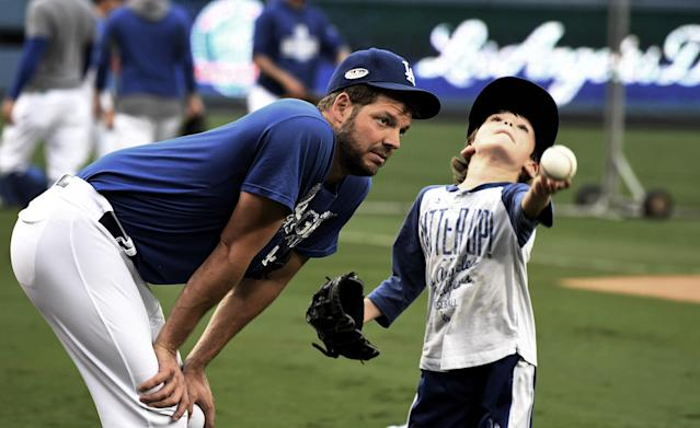 Los Angeles Dodgers pitcher Rich Hill and his son, Brice. (Getty Images)