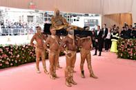 After showing up to the Oscars in an unforgettable tuxedo dress earlier this year, Tony Award winner Billy Porter topped himself at the Met, when he arrived at the event being carried by six topless men dressed in gold. Photo: Getty Images