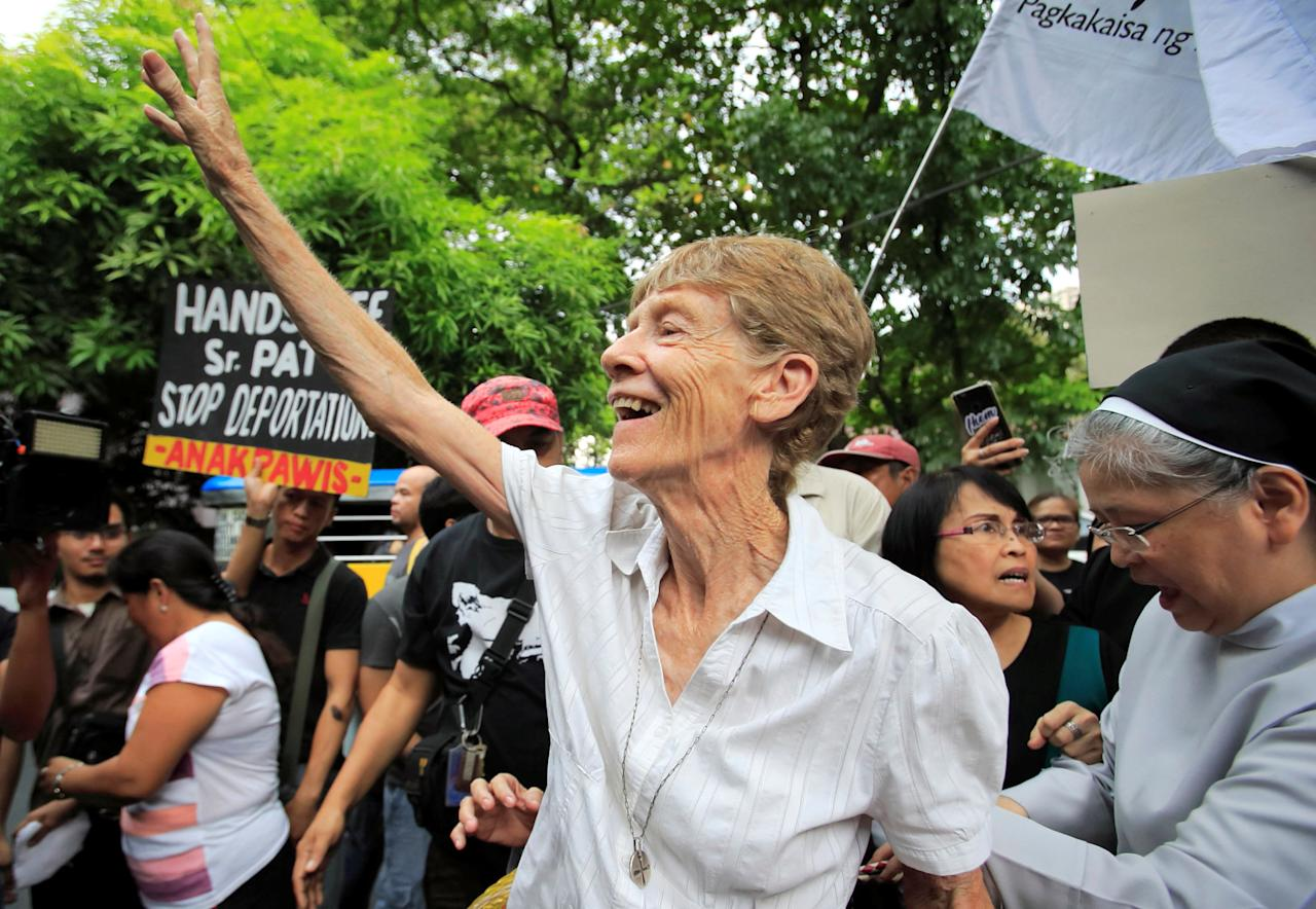 Australian missionary Patricia Fox waves to her supporters before filing a petition calling for the review of her deportation case at the Department of Justice, after the immigration bureau voided her visa following complaints from Philippine President Rodrigo Duterte about her participation in protest rallies, in Padre Faura, metro Manila, Philippines May 25, 2018. REUTERS/Romeo Ranoco