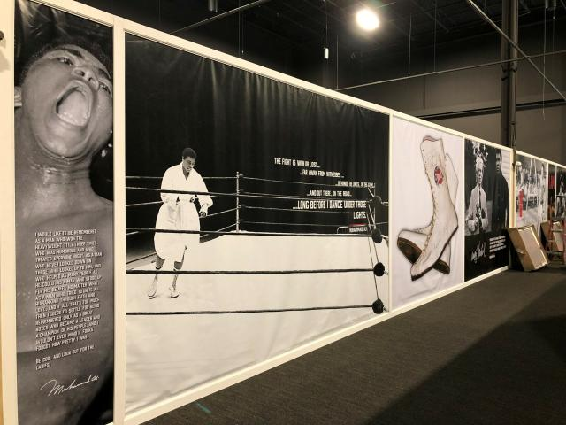 The Muhammad Ali museum-style exhibit an exhibition hall at the Graceland tourist attraction on Wednesday, May 22, 2019, in Memphis, Tenn. Presley and Ali were known to be friends. Presley once gave Ali a custom-made robe in Las Vegas in the early 1970s. A replica of that robe is part of the Ali exhibit, along with photos of the heavyweight boxing and civil rights champion and other artifacts. (AP Photo/Adrian Sainz)