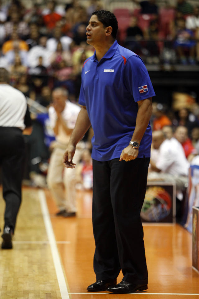Dominican Republic head coach Orlando Antigua give instructions to his players from the sidelines during a Tuto Marchand Cup basketball game against Puerto Rico in San Juan, Puerto Rico, Friday, Aug. 23, 2013. (AP Photo/Ricardo Arduengo)