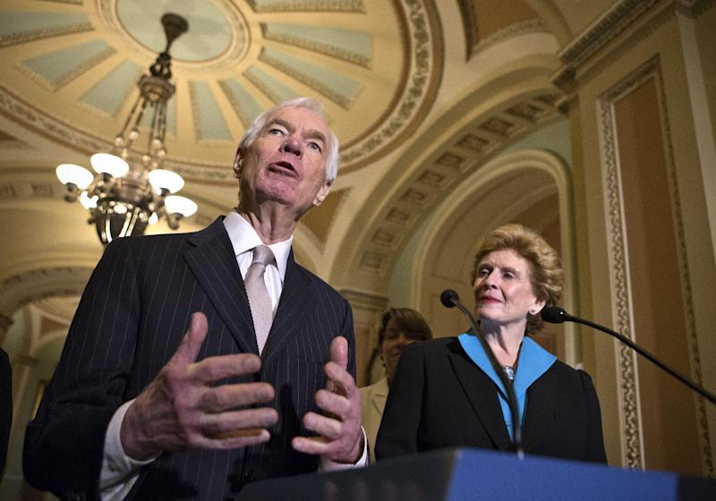 Sen. Thad Cochran, R-Miss., the ranking member of the Senate Agriculture Committee, left, and Sen. Debbie Stabenow, D-Mich., the committee chair, speak to reporters as the Senate votes on a farm bill that sets policy for farm subsidies, food stamps and other farm and food aid programs for the next five years, at the Capitol in Washington, Monday, June 10, 2013. Officially known as the Agriculture Reform, Food and Jobs Act of 2013, the agriculture policy measure would cost taxpayers $100 billion annually with the bulk of that amount allocated to the federal food stamp program which helps low-income families buy food. (AP Photo/J. Scott Applewhite)