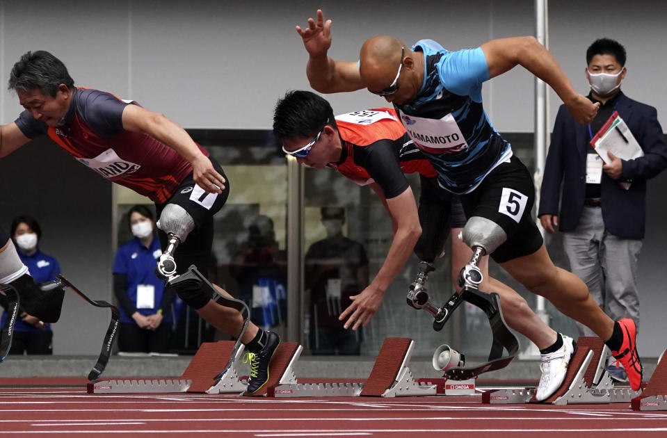 FILE - In this May 11, 2021, file photo, Japanese Japanese Atsushi Yamamoto (5) competes in the men's long jump T12 during an athletics test event for the Tokyo 2020 Paralympics Games at National Stadium in Tokyo, Tuesday, May 11, 2021. The opening next week of the Paralympic Games in Tokyo is being used as a stage to launch a human rights movement aimed at the world's 1.2 billion people with disabilities. (AP Photo/Shuji Kajiyama)