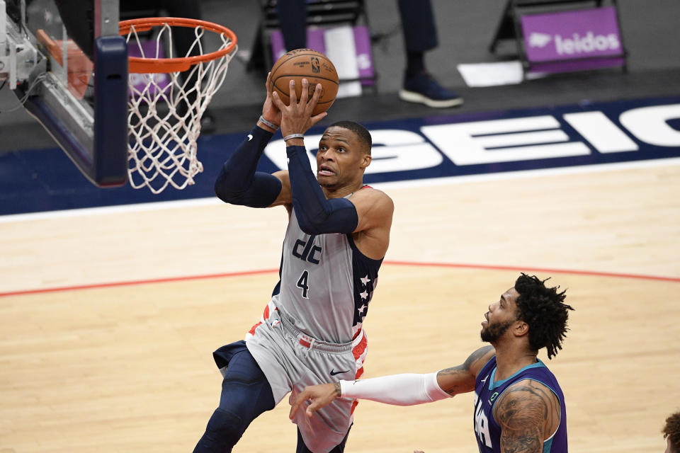 Washington Wizards guard Russell Westbrook (4) goes to the basket past Charlotte Hornets forward Miles Bridges (0) during the first half of an NBA basketball game, Sunday, May 16, 2021, in Washington. (AP Photo/Nick Wass)