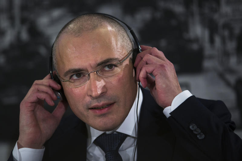 Mikhail Khodorkovsky, listens to questions at his first news conference after his release in Berlin, Sunday, Dec. 22, 2013. The former oil baron and prominent critic of Russian President Vladimir Putin, Mikhail Khodorkovsky, was reunited with his family in Berlin on Saturday, a day after being released from a decade-long imprisonment in Russia. (AP Photo/Markus Schreiber)