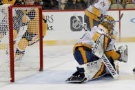 A shot by Pittsburgh Penguins' Alex Galchenyuk gets by Nashville Predators goaltender Pekka Rinne for a goal during the second period of an NHL hockey game, Saturday, Dec. 28, 2019, in Pittsburgh. (AP Photo/Keith Srakocic)
