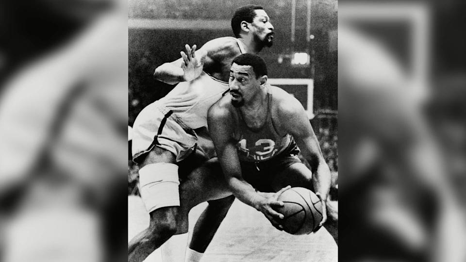 Mandatory Credit: Photo by AP/Shutterstock (7328231a)Boston Celtics Bill Russell and Wilt Chamberlain of the Philadelphia 76ers in playoff actionCeltice 76ers Basketball.