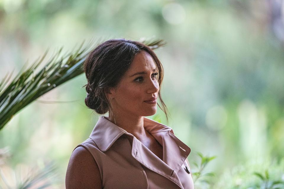 Meghan, the Duchess of Sussex arrives at the British High Commissioner residency where she  will meet with Graca Machel, widow of former South African president Nelson Mandela, in Johannesburg, on October 2, 2019. - Prince Harry recalled the hounding of his late mother Diana to denounce media treatment of his wife Meghan Markle, as the couple launched legal action against a British tabloid for invasion of privacy. (Photo by Michele Spatari / AFP) (Photo by MICHELE SPATARI/AFP via Getty Images)