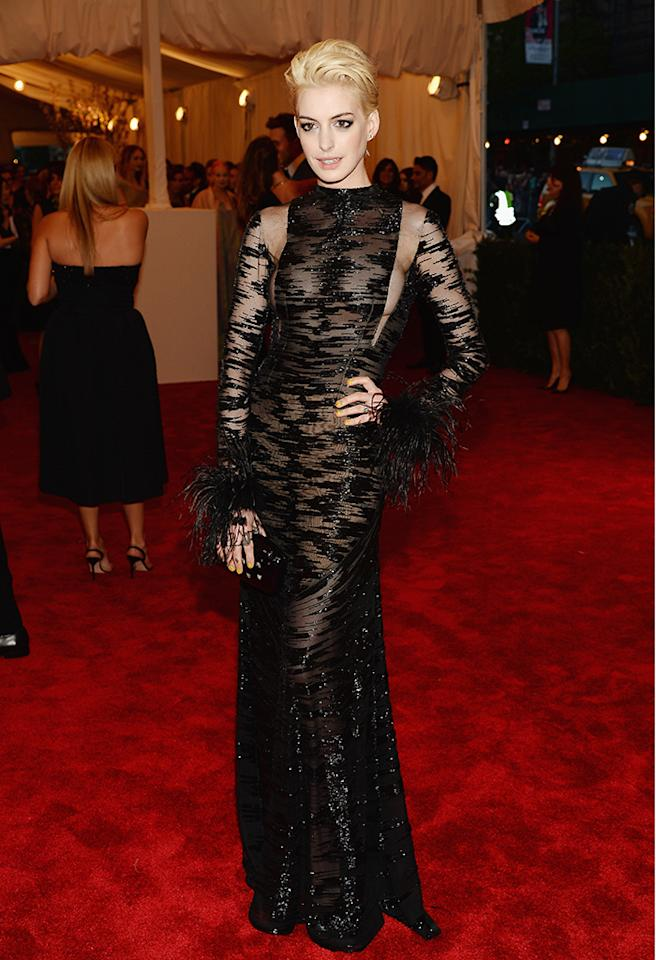 Anne Hathaway glammed up the punk party in a vintage Valentino black gown, which covered every inch of her but still showed plenty thanks to see-thru panels. A new blond 'do completed the Oscar winner's gorgeous look.