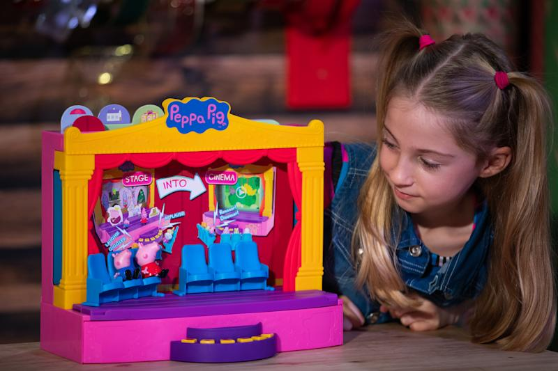 Liana Pierce, 7, plays with a Peppa Pig Peppa's Stage playset by Character Options, which was named in the top 12 to buy during the unveiling of the annual DreamToys list at St Mary's Church in Marylebone, London. (Photo by Aaron Chown/PA Images via Getty Images)