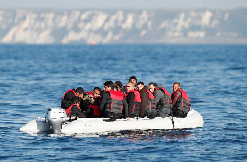 Migrants who launched from the coast of northern France cross the English Channel in an inflatable boat near Dover