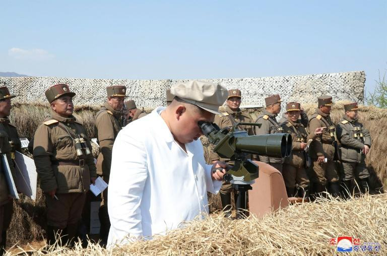 The weapons test came a day before North Korea marks the 108th anniversary of the birth of founder Kim Il Sung, grandfather of current leader Kim Jong Un, pictured inspecting a mortar unit drill
