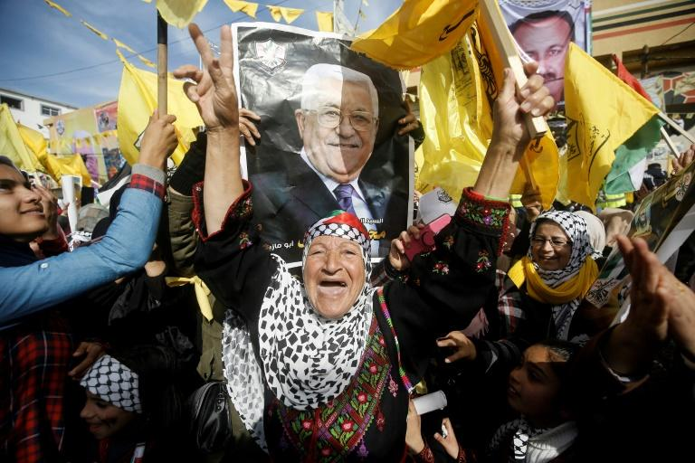 Fatah supporters hold the portrait of Palestinian president Mahmud Abbas during a rare rally in Gaza
