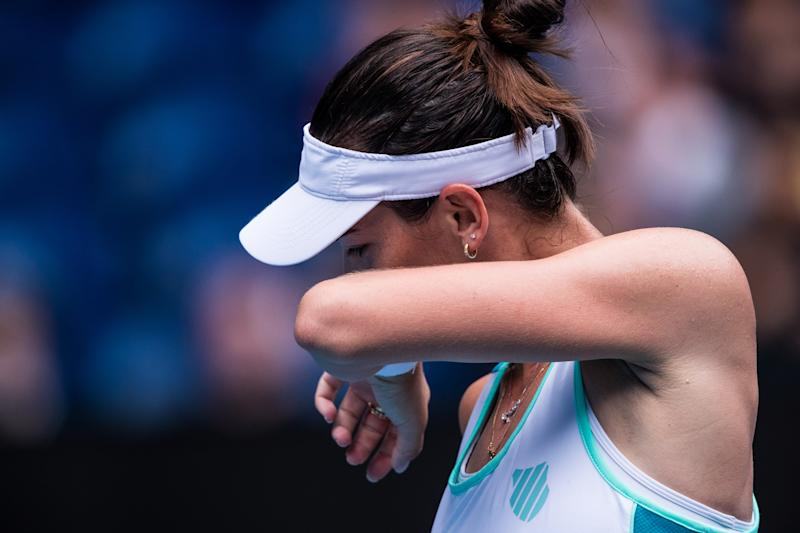 Ajla Tomljanovic of Australia reacts during her second round match against Garbione Muguruza of Spain on day four of the 2020 Australian Open at Melbourne Park on January 23, 2020 in Melbourne, Australia. (Photo by Chaz Niell/Getty Images)