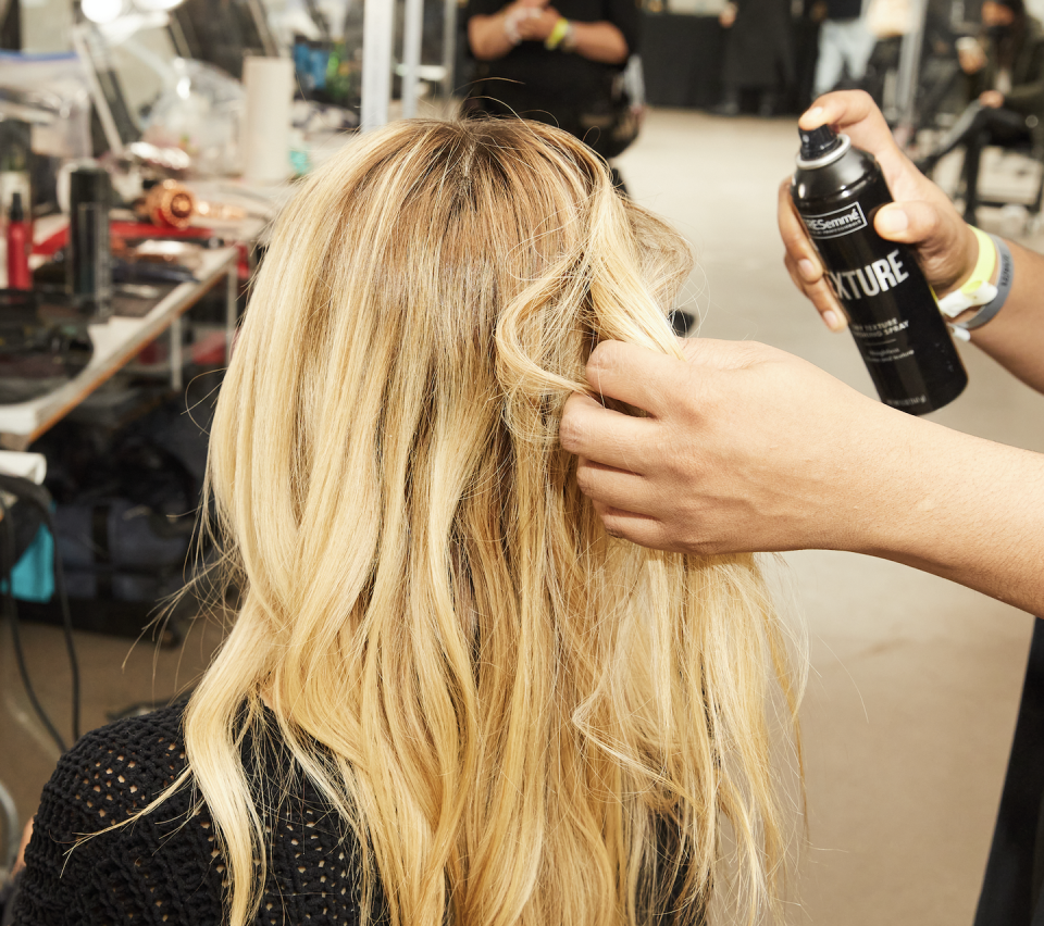 """<p>To achieve this look Laswell says to section dampened hair into medium-sized portions and then """"apply the <a href=""""https://www.ulta.com/volume-thickening-spray?productId=pimprod2022685&catargetid=330000200002232597&CAPCID=438981189740&CATCI=aud-842462607482:dsa-897920745743&CAAGID=100892732620&CADevice=c&gclid=Cj0KCQiA7NKBBhDBARIsAHbXCB7NugA20Q-3eV9qcQ-qnODDEkIzis-Nfz0ry9JDO-Bz-ATUwZq-uNMaAvl7EALw_wcB"""" rel=""""nofollow noopener"""" target=""""_blank"""" data-ylk=""""slk:TRESemmé Volume Thickening Spray"""" class=""""link rapid-noclick-resp"""">TRESemmé Volume Thickening Spray</a> from roots to end."""" Lift the sectioned hair straight up and while blowdrying spritz generously the <a href=""""https://www.ulta.com/dry-texture-finishing-spray?productId=pimprod2022757"""" rel=""""nofollow noopener"""" target=""""_blank"""" data-ylk=""""slk:TRESemmé Dry Texture Finishing Spray"""" class=""""link rapid-noclick-resp"""">TRESemmé Dry Texture Finishing Spray</a>. To achieve soft waves wrap sectioned hair around the barrel of a curling iron in one direction and then rotate in the opposite direction for a few seconds. Use the <a href=""""https://www.ulta.com/keratin-smooth-keratin-infusing-smoothing-serum?productId=xlsImpprod5180503&sku=2256100&_requestid=1076913"""" rel=""""nofollow noopener"""" target=""""_blank"""" data-ylk=""""slk:TRESemmé Keratin Smooth Shine Serum"""" class=""""link rapid-noclick-resp"""">TRESemmé Keratin Smooth Shine Serum</a> to add a natural sheen in the mid and ends of hair. For a final once-over and soft hold mist the <a href=""""https://www.ulta.com/compressed-micro-mist-boost-hold-level-3-hair-spray?productId=xlsImpprod17772001&sku=2522128&_requestid=1077702"""" rel=""""nofollow noopener"""" target=""""_blank"""" data-ylk=""""slk:TRESemmé Compressed Micro Mist Hair Spray Boost Level 3"""" class=""""link rapid-noclick-resp"""">TRESemmé Compressed Micro Mist Hair Spray Boost Level 3</a> all over the hair.<br></p>"""