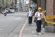 People wear face masks to help protect against the spread of the coronavirus after the COVID-19 alert rose to level 3 in Taipei, Taiwan, Tuesday, May 18, 2021. (AP Photo/Chiang Ying-ying)