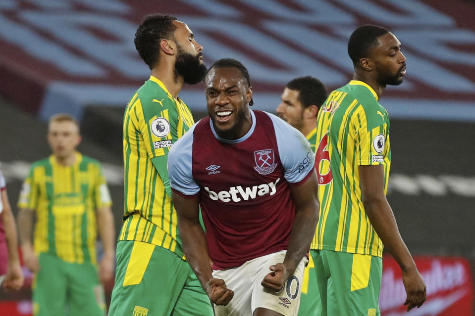 West Ham's Michail Antonio, centre, celebrates after scoring his side's second goal during an English Premier League soccer match between West Ham and West Bromwich Albion at the London Stadium in London, England, Tuesday Jan.19, 2021. (Matthew Childs/Pool via AP)