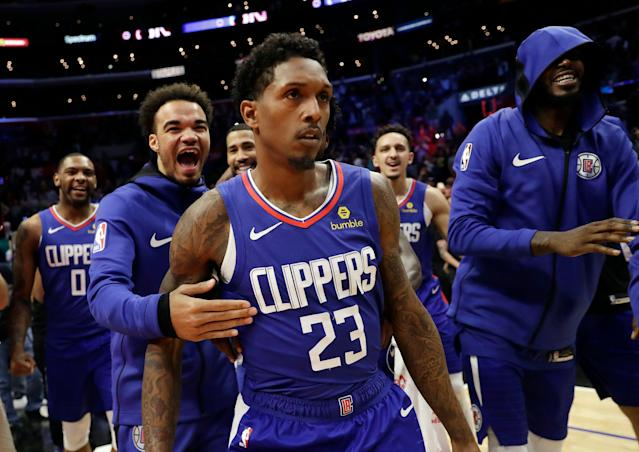 Clippers guard Lou Williams (23) is mobbed by teammates after making the game-winning shot as time expired. (AP Photo/Marcio Jose Sanchez)