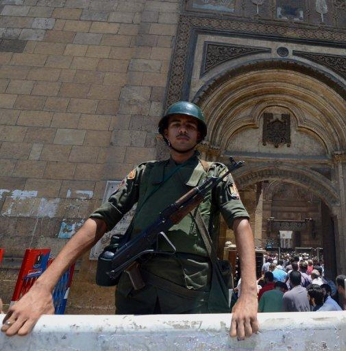 An Egyptian presidential guard stands outside Cairo's Al-Azhar mosque as president-elect Mohamed Morsi performs weekly prayers at the historic mosque