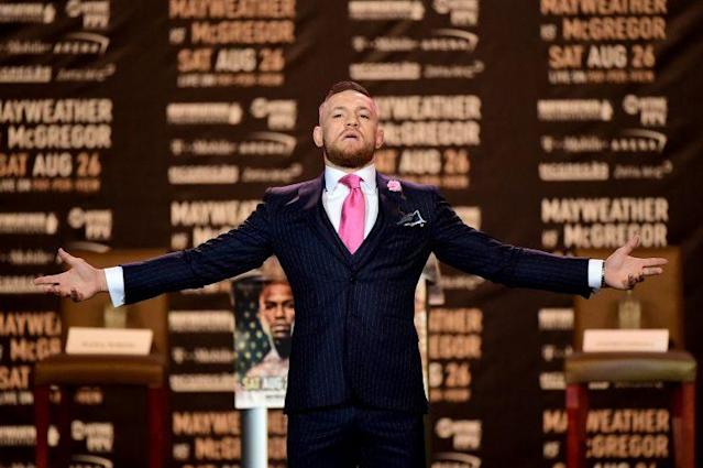 Conor McGregor shows off his custom suit during the Las Vegas press tour (Getty Images).