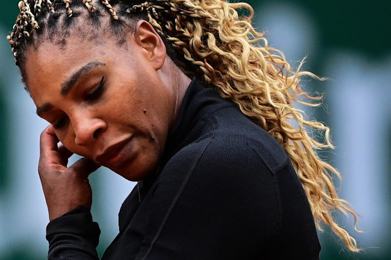 Serena Williams reacts as she plays against Kristie Ahn during their women's singles first round tennis match at Roland Garros 2020.